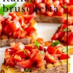 PIN IMAGE - Tomato Bruschetta on a white plate with text overlay