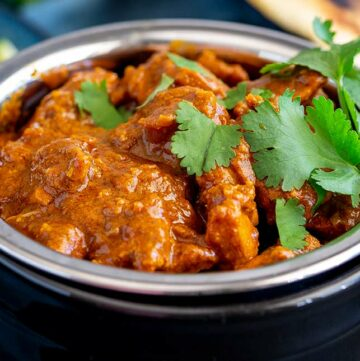 close up of Rogan Josh in a black and metal bowl