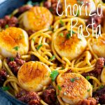 a picture of the scallop chorizo pasta, with text overlay for using on pinterest