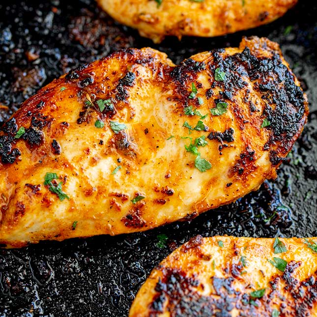 overhead view of a charred chicken breasts