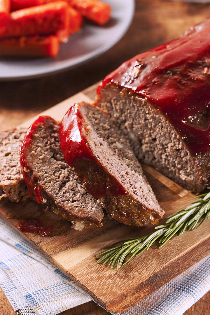 a tomato glazed meatloaf on a wooden board
