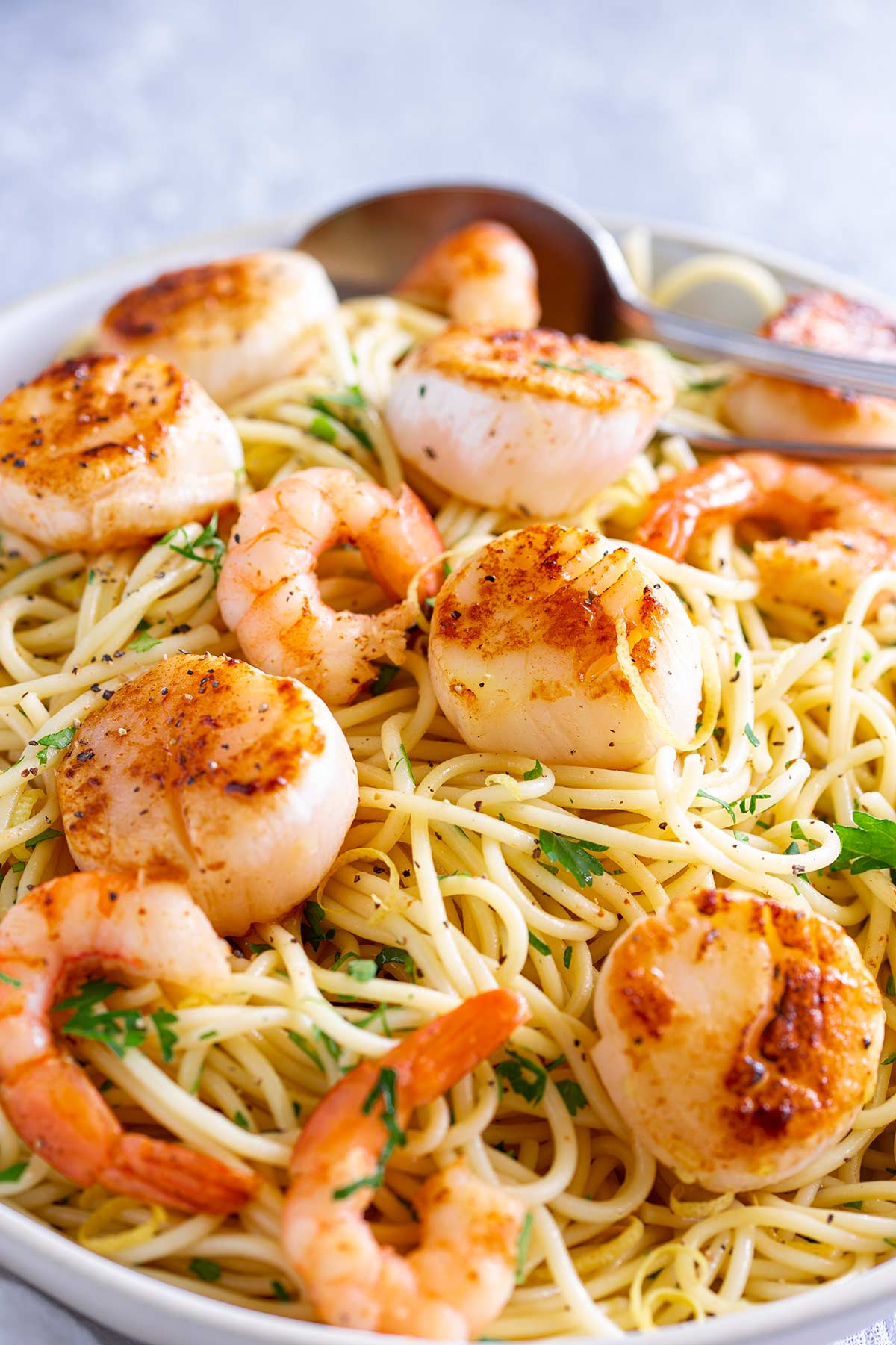 scallops and prawns on a bed of pasta